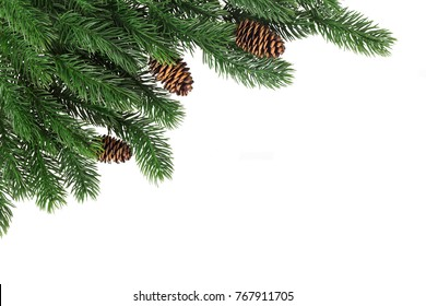 Fir branches with cones in the corner on a white background isolated. New Year card template.
