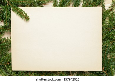 fir branches on old paper, vintage christmas background