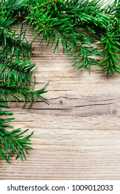 Fir garland on wooden background, copy space.