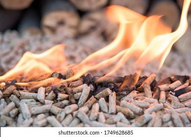 Fir Pellets in flames- close up of biomass