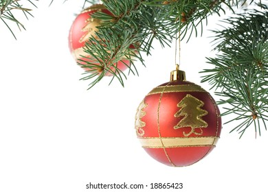 Fir tree branch with decoration on a white background. Close up. Christmas decoration.