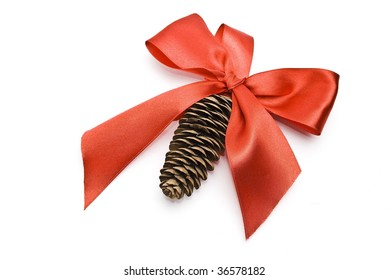 Fir tree cone and red bow. Christmas decorated