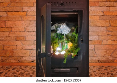 Fir tree forest, clouds and rain inside a cozy fireplace inside a country cottage. Imagination and creativity to create your own personal magical forest.