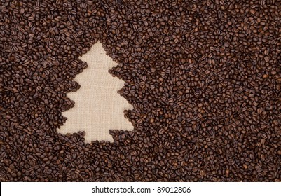 Fir tree made of roasted coffee beans on burlap