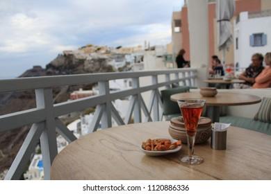 Fira, Santorini, Greece - OCT 04 2017: Vinsanto Wine and Wating for Santorini Fira Beautiful night view