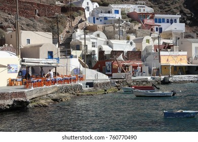 FIRA, SANTORINI ISLAND, GREECE - NOVEMBER 2, 2016:  A panoramic view of the old harbor of Fira village on Santorini Island, Greece.
