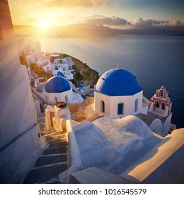 Fira town on Santorini island, Greece. Incredibly romantic sunrise on Santorini. Oia village in the morning light. Amazing sunset view with white houses. Island lovers