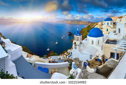 Fira town on Santorini island, Greece. Incredibly romantic sunrise on Santorini. Oia village in the morning light. Amazing sunset view with white houses. Island lovers. 3 Blue domes