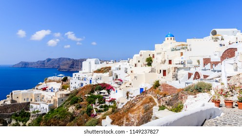 Fira town on Santorini Island, Greece. Oia village in the summer.  Whitewashed houses and blue dome church by the Aegean Sea. Santorini is the lovers island.