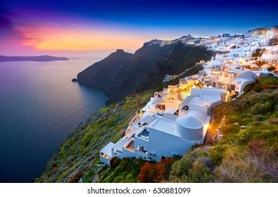 Fira town on Santorini island, Greece. Incredibly romantic sunset on Santorini. Oia village in the morning light. Amazing sunset view with white houses. Island lovers