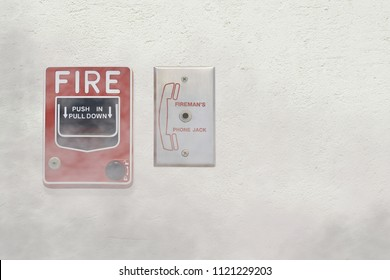 Fire Alarm Notifier and Fireman's Phone Jack on Cement Plaster Wall with Smoke Effect, Security Concept