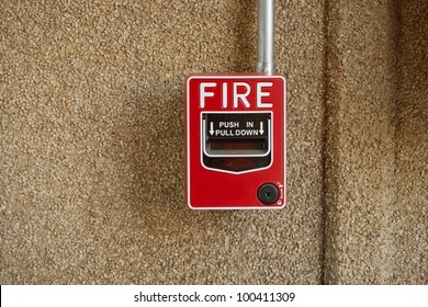 Fire alarm on office wall