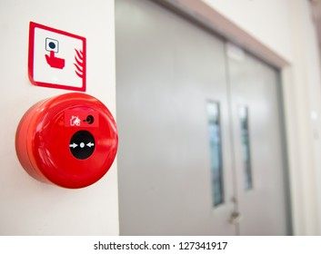 Fire alarm on the wall.