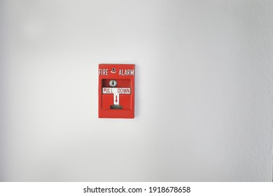 Fire alarm on the white wall.