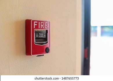Fire alarm switch on the wall in factory.