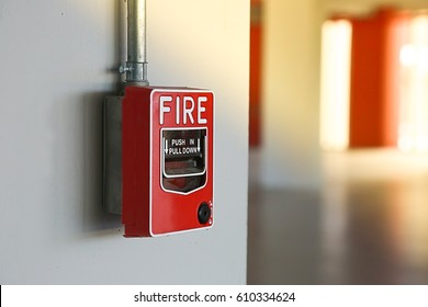 Fire alarm switch on the wall.