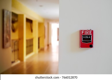 fire alarm system box installed on wall in building.