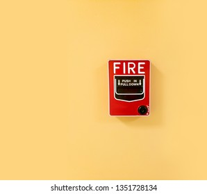 Fire alarm system notifier on a yellow wall.  Bell warning equipment for use when on fire (Manual Pull Station)