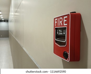 Fire alarm and telephone jack on white wall Emergency concept.