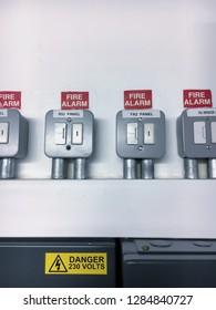 Fire alarm units above a fuse box