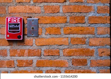 fire alarms on old brick walls. Equipment or fire alarms in red boxes for those who are exposed to fires or severe incidents to evacuate people from the building and warn that they are dangerous.