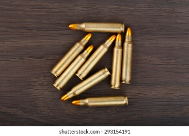 Fire arm bullet cartridges on a old wooden floor.