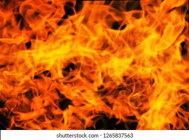 fire background blur in orange color.black background