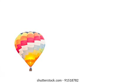 Fire balloon during a foggy day on white background