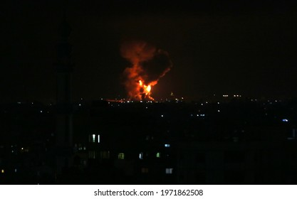 Fire billow from Israeli air strikes in Rafah the southern Gaza Strip, controlled by the Palestinian Islamist movement Hamas. May 11, 2021. Photo by Abed Rahim Khatib