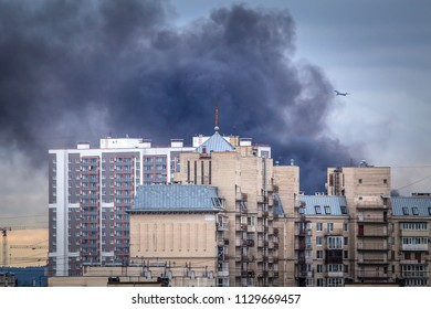 Fire. Black smoke over the building. City fire. Smoke from a fire.