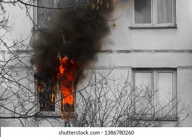 Fire and black smoke in the window