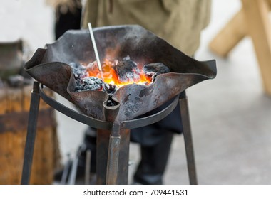 fire blacksmith forge handmade burnt metal with winding wavy edges