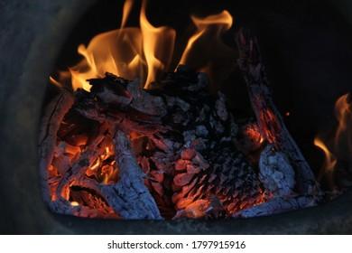 Fire blazing in an earthenware chimnea.