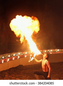 Fire Breathing Circus Show. Large Plume Of Flame