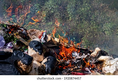 fire burn garbage waste plastic, smoke polluted of waste plastic incineration, garbage waste disposal with burnt incinerate, fire flame garbage burning and smoke air pollution
