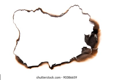 Fire burned hole in white paper