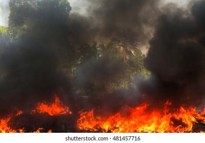 Fire burning with black smoke