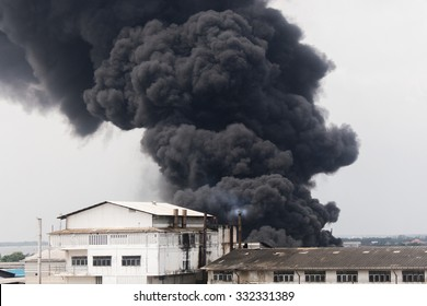 Fire burning and black smoke over the Factory.