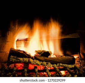 Fire burning bright in fireplace. Isolated. Stock Image.