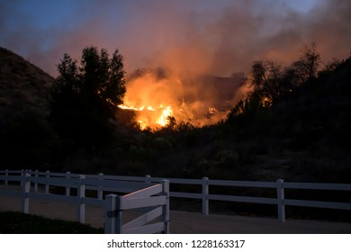 Fire Burning Hill Just Beyond White Park Fence in California Woo