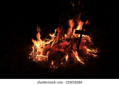 The fire burning at night outdoors