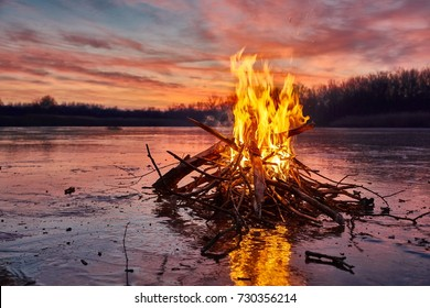 Fire burning on ice of a frozen lake