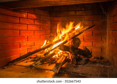 Fire burning in  red brick fireplace, Greece