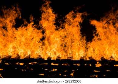 Fire burning wood pile , closeup abstract background