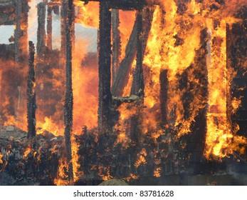 fire burning wooden frame house