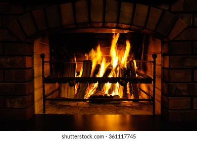 Fire burns in a fireplace