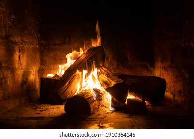 A fire burns in a fireplace, Fire to keep warm. Winter time