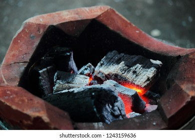 Fire in charcoal brazier