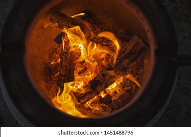 fire with charcoal in a compact home tandoor at the cottage