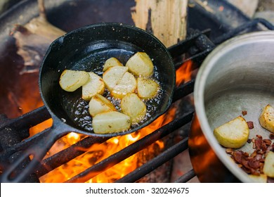 Fire cooked meal, roasted potatoes